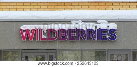 15.02.2020 Syktyvkar, Russia, Signboard Wildberries Covered Snow On Wall A Residential Building. Sto