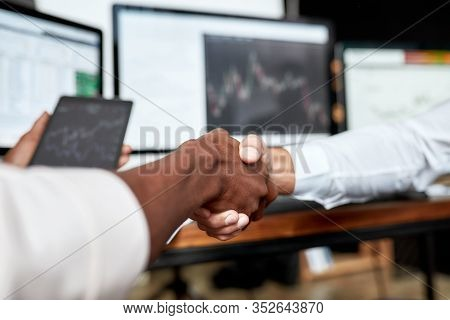 Close Up Shot Of Business Handshake. Two Businessmen, Traders Reaching An Agreement And Making A Dea
