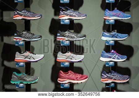 Minsk, Belarus - January 29, 2020: Sneakers On The Shelves Of A Sportswear Store Asics.