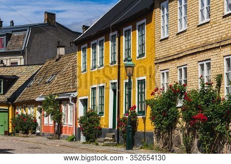 Lund, Sweden - June 24, 2018: Small Cottages On A Cobblestoned Street In The Historic Parts Of The U
