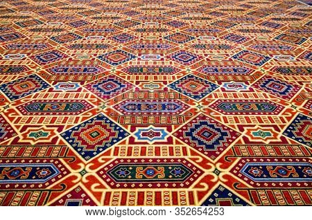 Colourful Patterened Carpet, Focus On Foreground With Diminishing Perspective.
