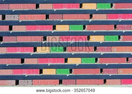 Freight Trains Hauling A Long Load Of Shipping Containers.