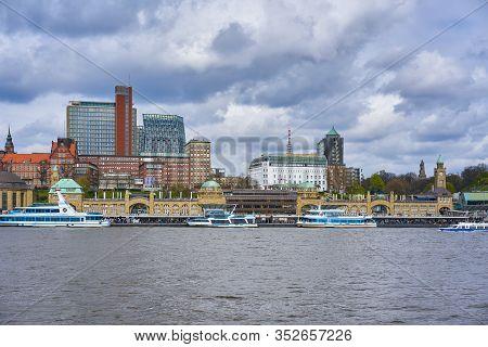 Hamburg, Germany - April 9, 2017: View Of St. Pauli's Pier Landungsbrücken Station Tower With Buildi