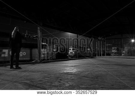 Chomutov, Czech Republic - February 16, 2020: Night On Empty Freight Train Station With Photographer