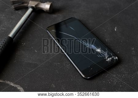 Cracked Mobile Smartphone Smashed By A Hummer.