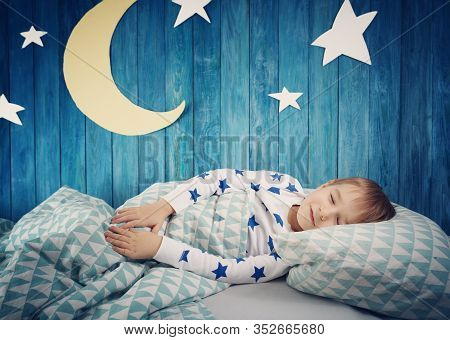 Five Years Old Child Sleeping In Bed