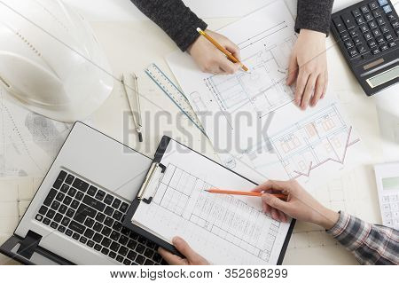 Architects Working On Blueprint, Real Estate Project. Architect Workplace - Architectural Project, B