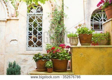 Flowers In Front Of Old Medieval Byzantine Church Of Saint Nicholas Rangavas (agios Nikolaos) Locate