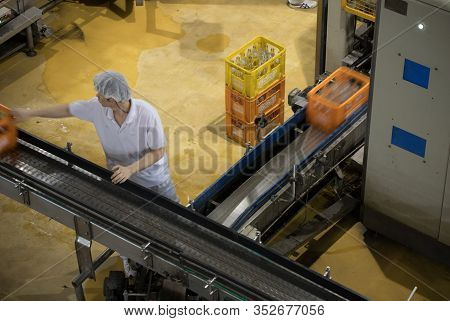 Beijing, China - June 01, 2019: Carbonated Drinks Factory With View Of Production And Bottles.