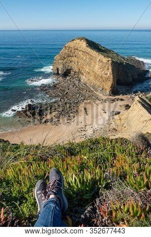 Woman Feet At Praia Dos Machados Beach In Costa Vicentina, Portugal