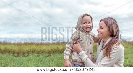 Young Family, Woman Mother, Child, Little Son Laughs Rejoices, Autumn Park. Emotions Comfort Pleasur