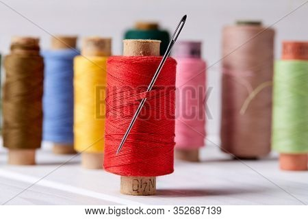 bobbins with thread and needles