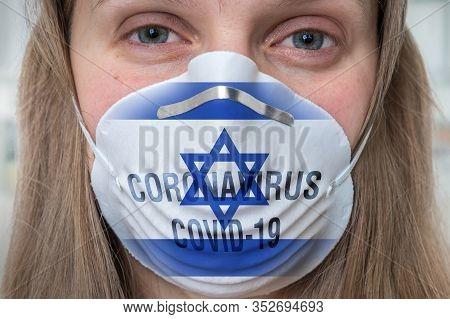 Woman Is Wearing Respirator Mask With Flag Of Israel - Coronavirus Covid-19 Epidemic Concept