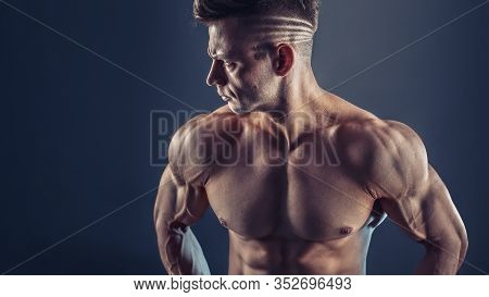 Shirtless Male Bodybuilder With Muscular Build Strong Abs Showing. Shot Of Healthy Muscular Young Ma