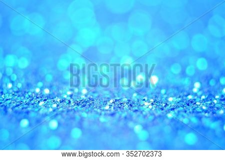 Lights On Blue Defocus Background. Bokeh Defocus Disco Effect. Holiday Abstract Background Christmas