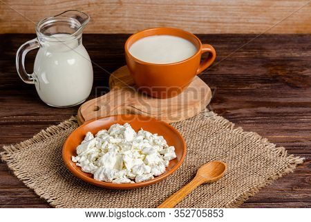 Homemade Fermented Milk Products - Kefir, Cottage Cheese On A Wooden Background. Healthy Eating Conc