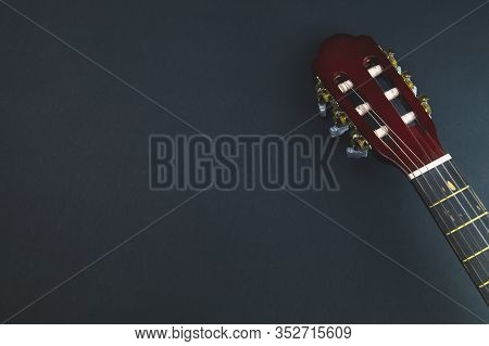 Guitar Headstock Close Up. Acoustic Musical Instrument. Copy Space