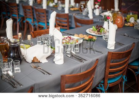 Restaurant Banquet Table. Wedding Catering Party Background. Elegant Hotel Celebration Venue. Silver