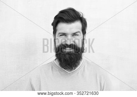 Man Bearded Hipster Stylish Beard Grey Background. Stylish Beard And Mustache Care. Happy Face. Hips