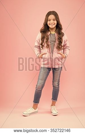 Fashion Is Her Life. Autumn Look Of Small Fashion Model. Happy Girl In Cozy Fashion Outfit On Pink B