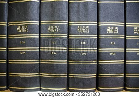 London, Uk - September 21, 2019: Bound Copies Of The British Medical Journal On A Shelf In A Referen