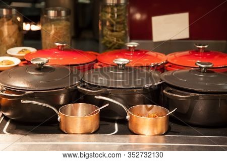 Food Serving In Vintage Iron Steel Cooking Pots In Hotel Restaurant Buffet Food Line. Industrial Coo