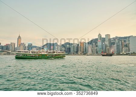 HONG KONG, CHINA - CIRCA JANUARY, 2019: a Star Ferry crossing Victoria Harbour at twilight.