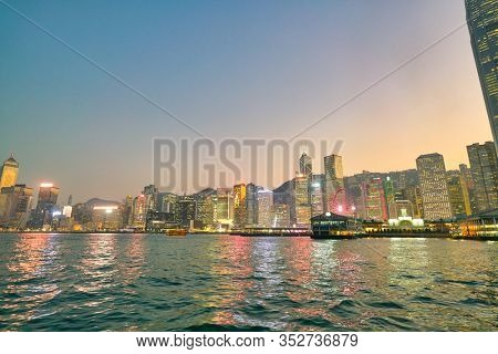 HONG KONG, CHINA - CIRCA JANUARY, 2019: Central and Western District as seen from Victoria Harbour at twilight.