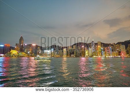 HONG KONG, CHINA - CIRCA JANUARY, 2019: Wan Chai and Central as seen from Victoria Harbour at twilight.