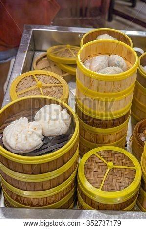 Steamed Dumplings In Dimsum Steamer Boxes In Hong Kong Restaurant