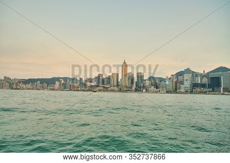 HONG KONG, CHINA - CIRCA JANUARY, 2019: Wan Chai as seen from Victoria Harbour at twilight.
