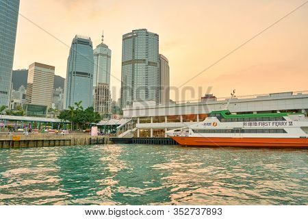 HONG KONG, CHINA - CIRCA JANUARY, 2019: view of Central Ferry Pier No.6 with Central District in the background as seen from Victoria Harbour at twilight.