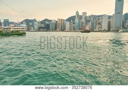 HONG KONG, CHINA - CIRCA JANUARY, 2019: Central as seen from Victoria Harbour at twilight.