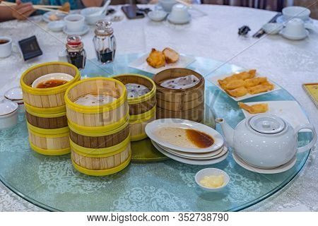 Empty Dimsum Bamboo Steamer Boxes And Plates On Dining Table