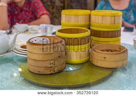 Hong Kong Dimsum Bamboo Steamer Boxes On Table In Restaurant