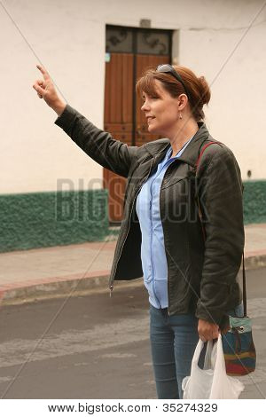 Woman flagging down a taxi