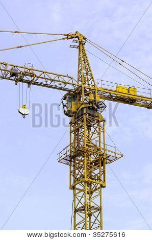 Yellow Hoisting Crane And Blue Sky