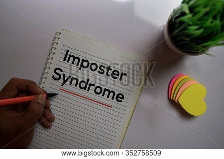 Imposter Syndrome Text On Sticky Notes Isolated On Office Desk
