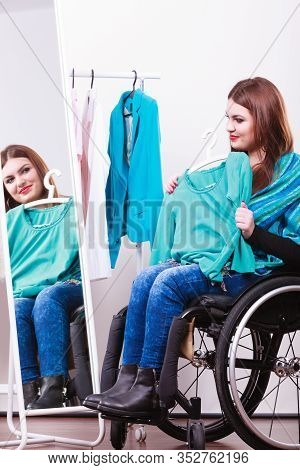 Real People, Disability And Handicap Concept. Teen Girl Handicapped Woman Sitting On Wheelchair Choo