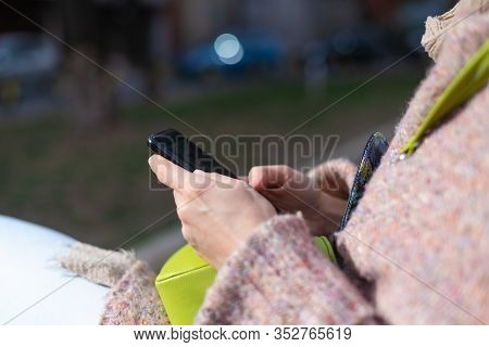 Hands Holding Cellphone. Woman Holding Cellphone. Hand Typing On Cellphone. Close Up Image Of Hands