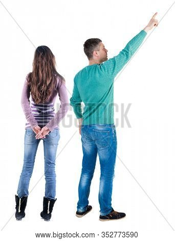 Back view of couple couple in sweater pointing. Rear view people collection. backside view of person. Isolated over white background.