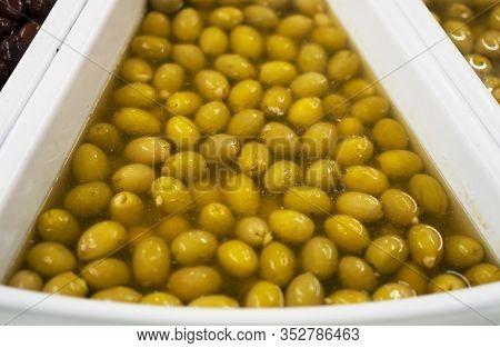 A Green Olives In Brine In Supermarket.