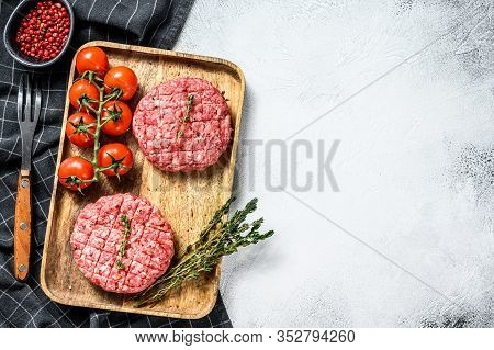 The Ground Beef Patties, Minced Meat Cutlets. Gray Background. Top View. Copy Space