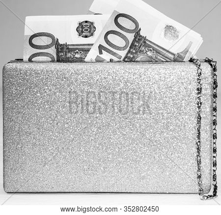 Glittery Silver Clutch Bag With Money Isolated On White Background With Copy Space.
