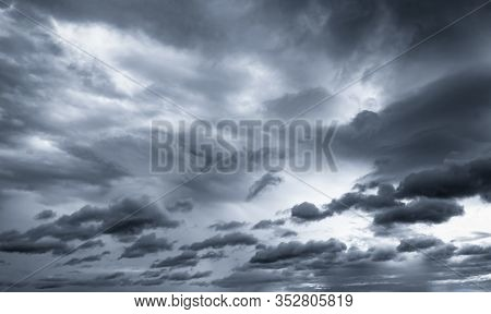 Dark Dramatic Sky And Clouds. Background For Death And Sad Concept. Gray Sky And Fluffy White Clouds