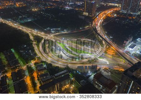 Aerial View Of Highway Junctions. Bridge Roads Shape Circle In Structure Of Transportation Concept.