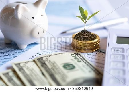 Calculating Tax Refund Or Income Tax Return For Saving Tax, Target For Save Coin In The Piggy Bank.
