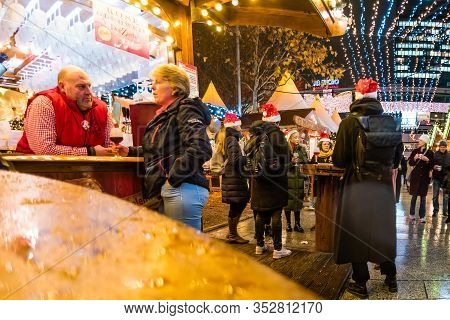 Christmas Market Near Kaiser Wilhelm Memorial Church In The Evening, Berlin, Germany