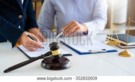 Women Lawyer Discussing With Clients In Courtroom. Justice And Law ,attorney, Court Judge, Meeting C