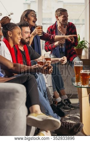 Excited Group Of People Watching Football, Sport Match At Home. Multiethnic Group Of Friend, Fans Ch